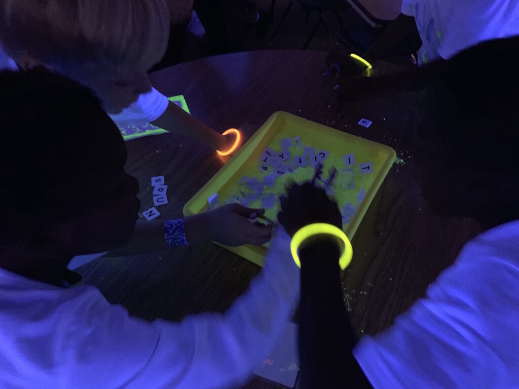 Classroom Transformation glow party for first grade.  Glow in the dark transformation for reading and math.
